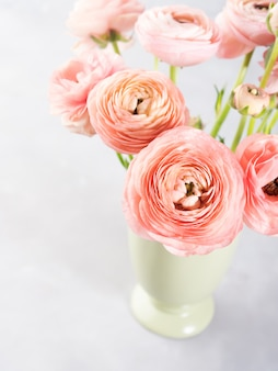 Beautiful pink ranunculus bouquet. woman mother's day wedding. holiday elegant bunch of flowers.