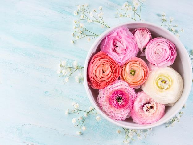 Beautiful pink ranunculus spring. woman mother's day wedding. holiday elegant flower arrangement