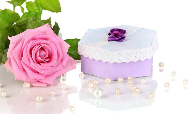 Beautiful pink rose with wonderful gift in purple box isolated on white