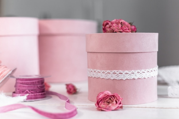 Beautiful pink round gift wrapping is decorated with narrowed roses