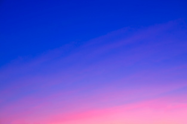 Beautiful pink sunset. for the background. blue sky