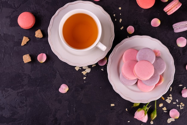 Beautiful pink tasty macaroons on a concrete background