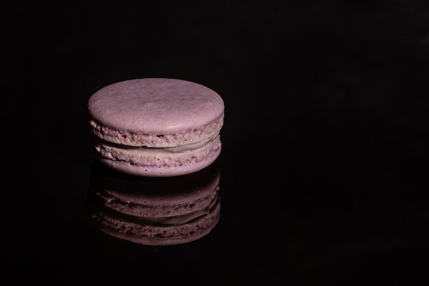 Beautiful pink tasty macaroons on a dark background