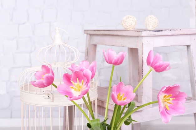 Beautiful pink tulips on grey wall