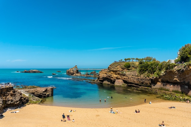The beautiful plage du port vieux on a summer afternoon where bathers can be seen bathing