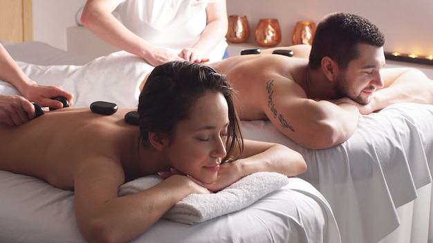 Beautiful pleasant couple having good time in modern wellness salon