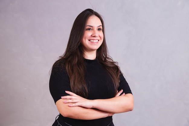 Beautiful plus size woman with arms crossed looking at camera