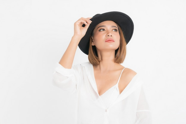 Beautiful portrait asian woman brown short bob wearing black hat and white shirt in stand position with fashion on isolated white background.
