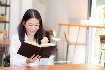 Beautiful portrait business asian young woman reading on notebook