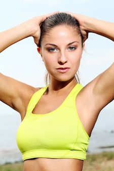 Beautiful portrait fitness girl wearing a yellow top