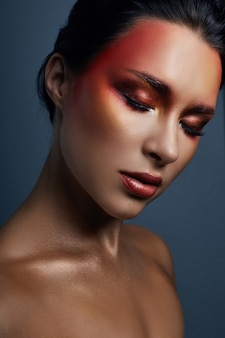 Beautiful portrait of woman with red bright makeup