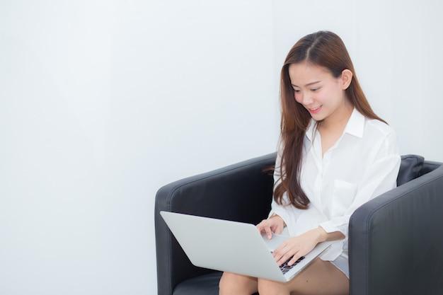 Beautiful of portrait young asian woman using laptop