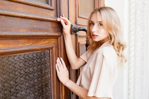 Beautiful portrait of young blonde woman outdoor. enjoy sunny day