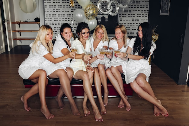 Beautiful and positive bide mades having fun on hen party.