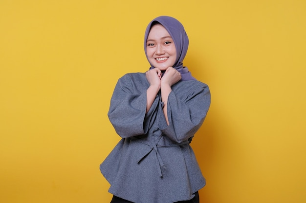 Beautiful positive friendlylooking young woman wearing hijab with lovely sincere smile feeling thankful and grateful