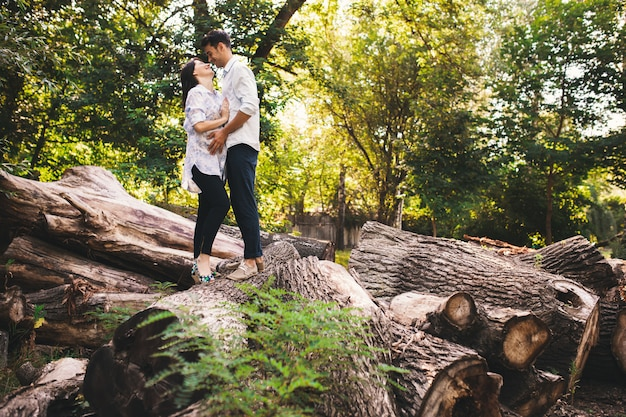 Beautiful pregnant couple relaxing outside in the forest