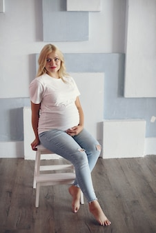 Beautiful pregnant woman with big belly in a studio