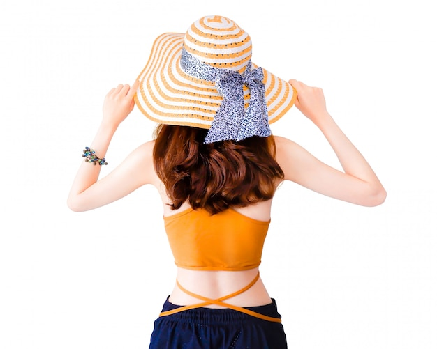 Beautiful pretty woman wearing a straw hat and sexy suit isolated.