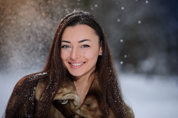 Beautiful pretty young woman in winter forest. portrait picture.