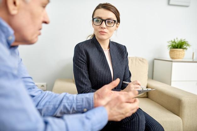 Beautiful psychiatrist consulting patient