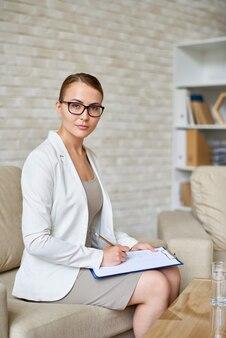 Beautiful psychiatrist in office