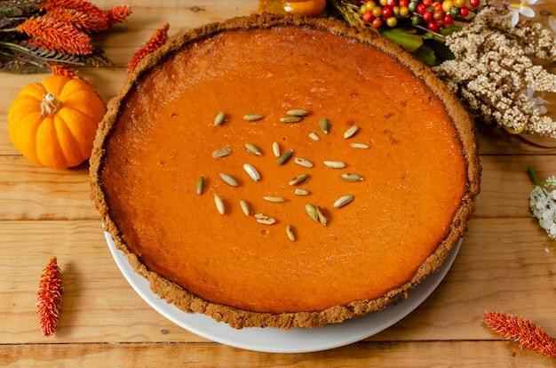Beautiful pumpkin pie on wooden table