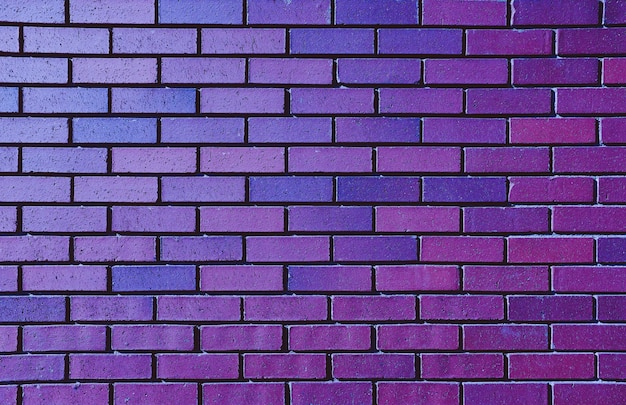 Красивая фиолетовая кирпичная стена для фона