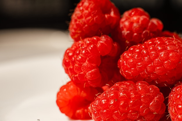 Beautiful raspberries isolated on a white background. cut out, close up. background and picture for postcard.