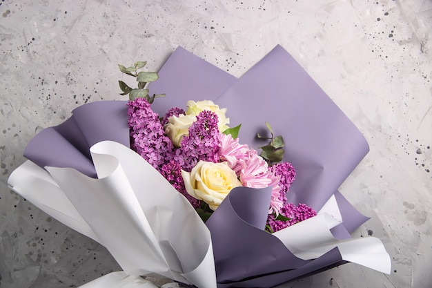 Beautiful ready to sell bouquet with lilac on the table florist