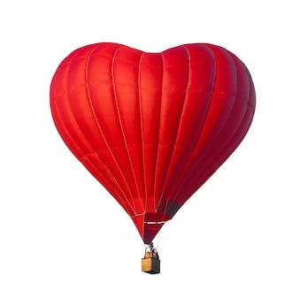 白い背景のロマンチックな日付に分離されたハートの形をした美しい赤い気球