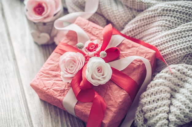Beautiful red gift box on wooden background