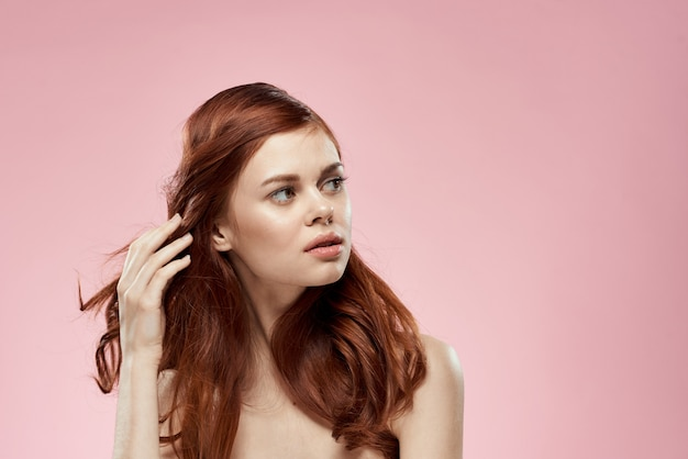 Beautiful red-haired woman with curly hair. hair care, healthy and shiny, without split ends