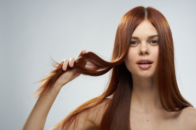 Beautiful red-haired woman with straight hair. healthy and shiny hair care