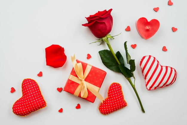 Beautiful red rose flower with hearts and gift box