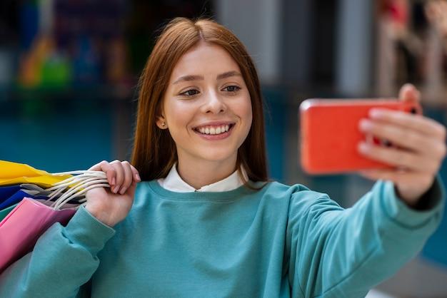 Beautiful redhead woman taking selfies