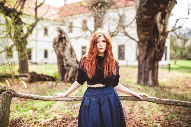 Beautiful redhead young woman outdoor portrait