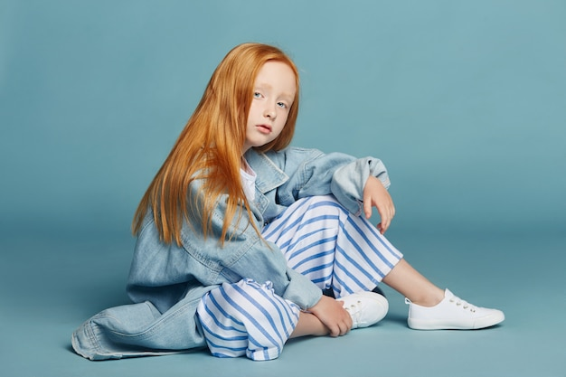 Beautiful redheaded baby girl with long hair