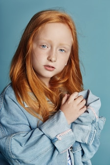 Beautiful redheaded baby girl with long hair