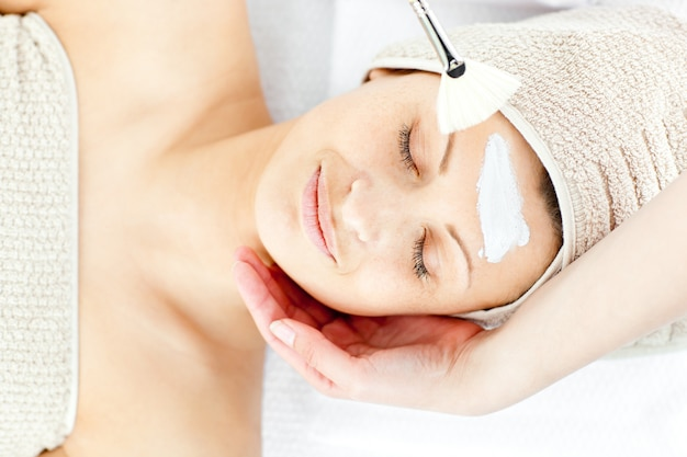 Beautiful relaxed woman receiving a beauty treatment