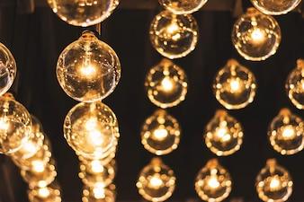 Beautiful retro light bulb decor glowing in the dark