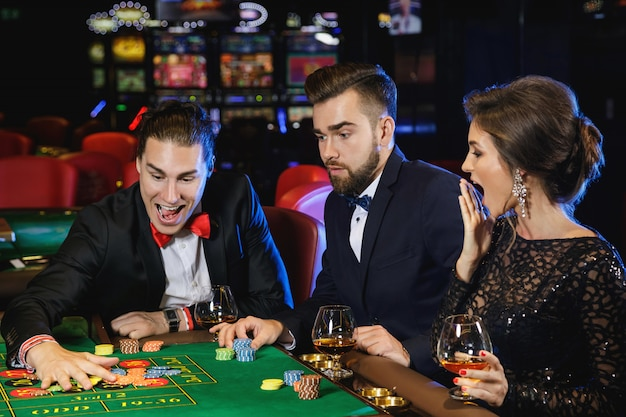 Beautiful and rich people playing roulette in the casino