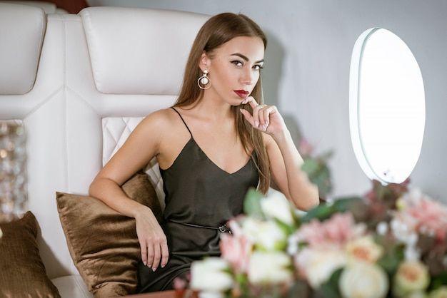 Beautiful rich woman in a private first class plane