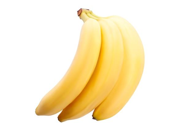 Красивые спелые бананы на белом фоне. изоляция