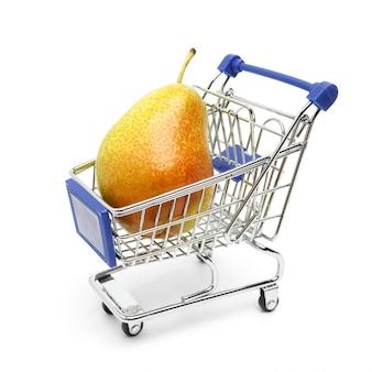 Beautiful ripe pear lies in a shopping cart