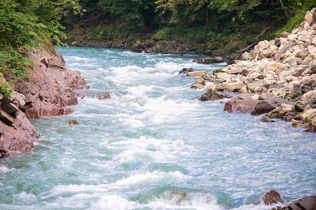 Beautiful river flows between the rocks