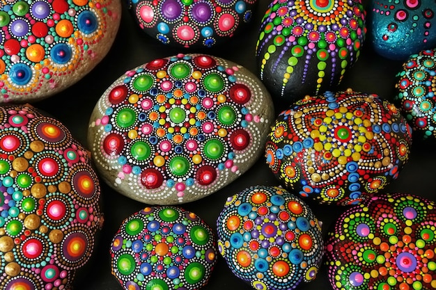 Beautiful rock mandalas painted with a brush