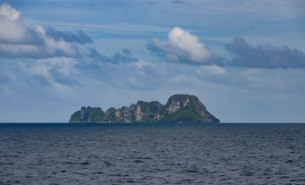 Beautiful rocky cliff near the sea under the dark cloudy sky