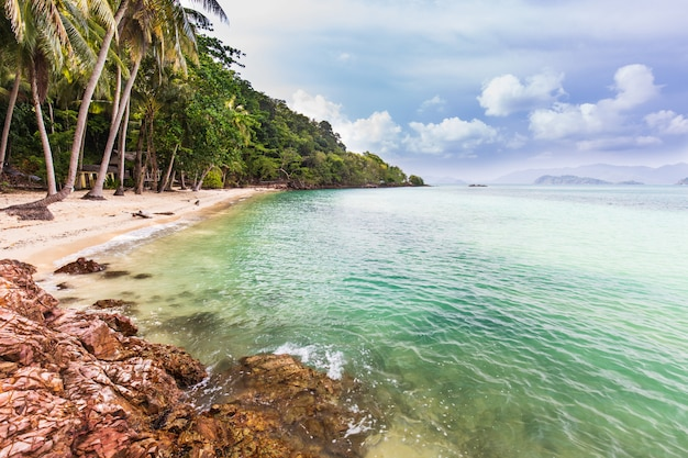 Beautiful rocky on seashore in tropical beach of koh wai, trat province, thailand.