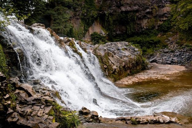 Beautiful rocky waterfall at daytime