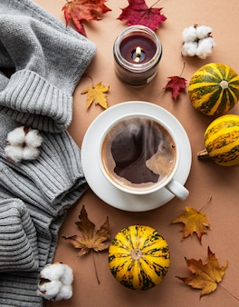 Beautiful and romantic autumn composition with cup of coffee